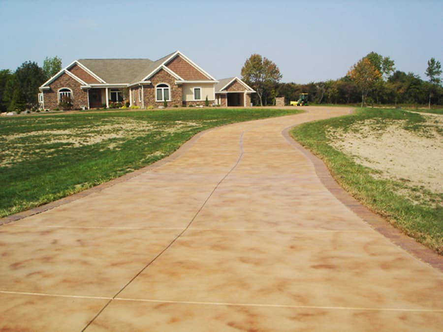 Beautiful long straight stained driveway