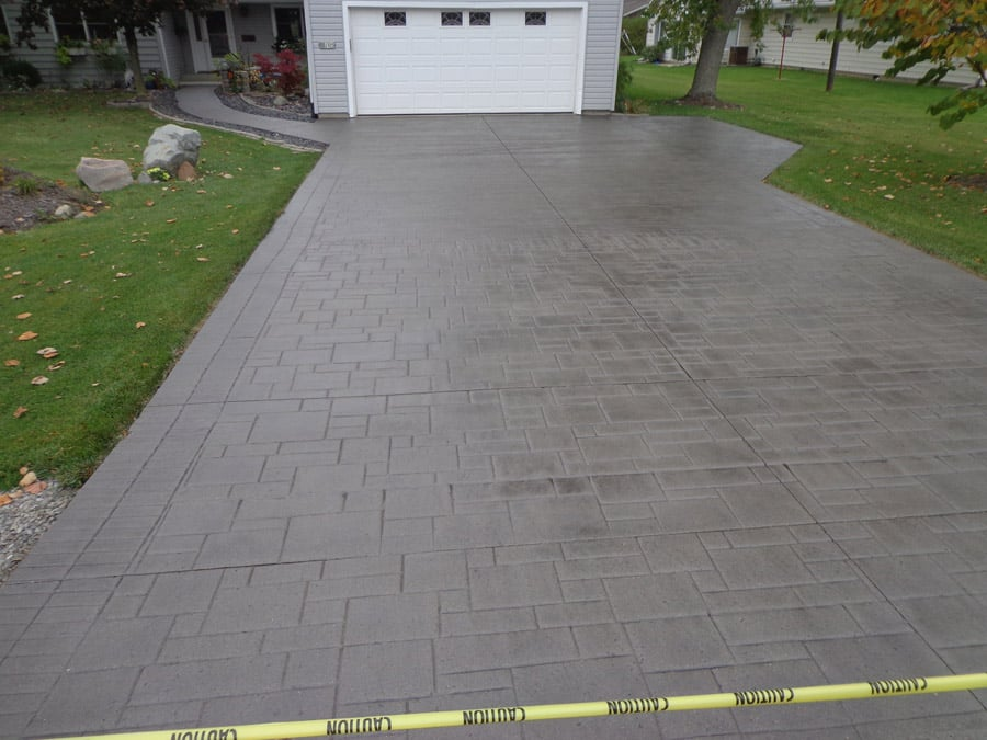 A straight concrete driveway for a garage in Fort Worth TX