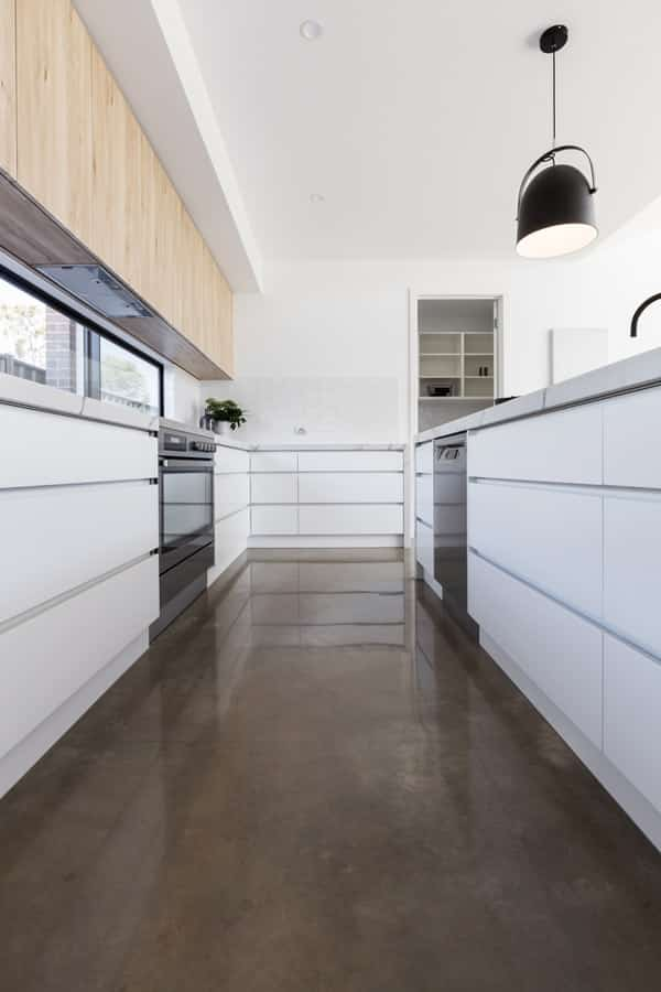 Clean kitchen with a newly installed polished flooring
