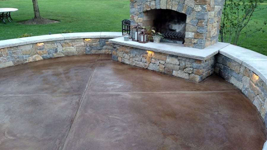 Stained concrete flooring patio with a fire place in Dallas TX
