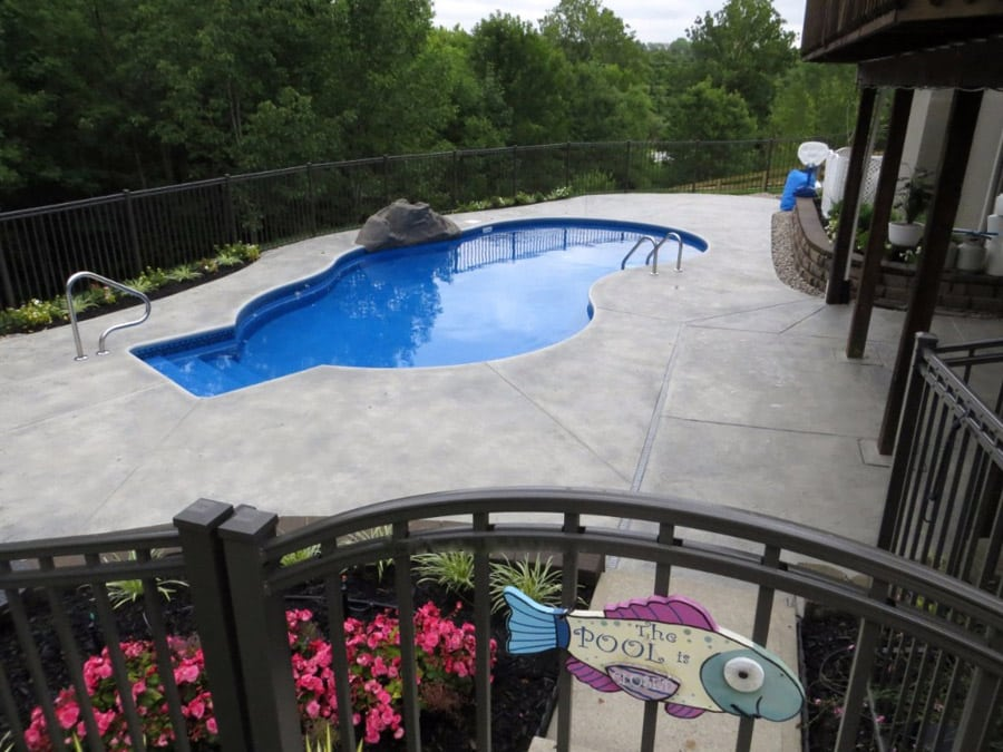 A resort pool deck with a decorative concrete flooring