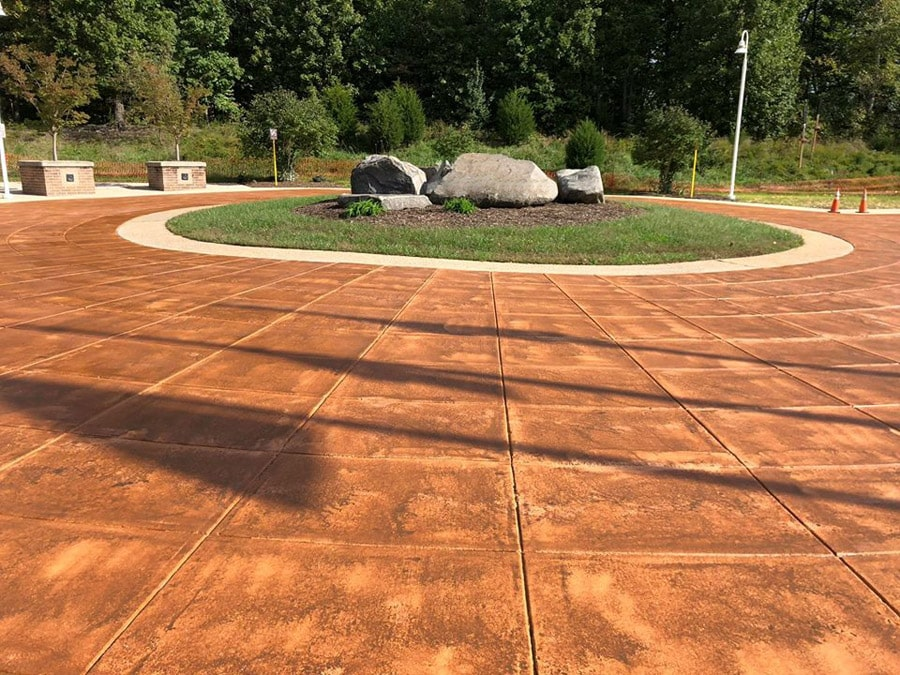 A patterned stained concrete driveway for a home in Dallas TX